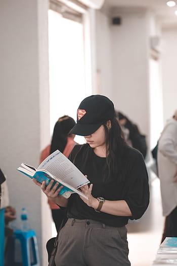 girl-coat-black-books-reading-royalty-free-thumbnail